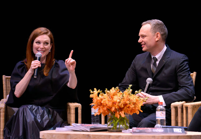 Actress Julianne Moore (L) and director Wash Westmoreland speak onstage at the 'Still Alice' US premiere during the 2014 Hamptons International Film Festival on October 13, 2014 in East Hampton, New York. (Photo by Eugene Gologursky/Getty Images)